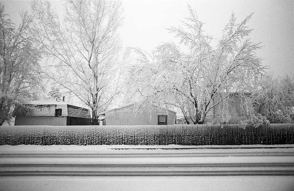 City street covered in snow in Boulder, Colorado.