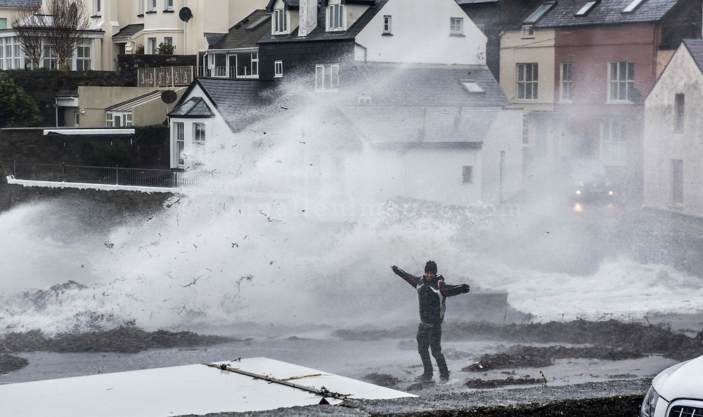 A brave or foolhardy man gets close to waves crashing into the town of Summercove near Kinsale..<br /> Picture. John Allen