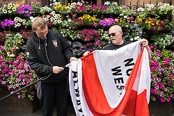 """© Licensed to London News Pictures . 24/06/2017. London, UK. EDL supporters on Whitehall . The English Defence League ( EDL ) hold a March on Parliament , from Charing Cross to Victoria Embankment , opposed by  a counter demonstration by Unite Against Fascism . Scotland Yard said it was using public order laws to restrict the marches """"due to concerns of serious public disorder, and disruption to the community"""" following terrorist attacks in Manchester , Westminster and Finsbury Park and the Grenfell Tower fire  . Photo credit: Joel Goodman/LNP"""