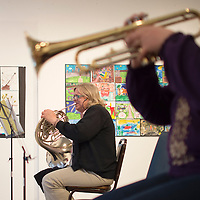 011113      Cayla Nimmo<br /> <br /> Lynn Foster plays her french horn during community band practice Tuesday evening art Art 123. The group has been meeting for about a month and is open to anyone who wants to attend. Practice is usually held at 6 pm Tuesday nights in El Morror Theater.
