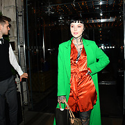 Grace Neutral wearing a green coat arrives at the Monroe Bergdorf celebrate her birthday wearing the orange lace cut out drape midi dress from Pretty Little Thing arrive at Berners Taver on 11 September 2019, London, UK.