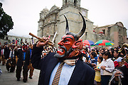 Men in devil masks parade through the Zocalo and past the cathedral during the Guelaguetza celebrations in Oaxaca City, Oaxaca, Mexico on July 19, 2008. The Guelaguetza is an annual folk dance festival in Oaxaca - dancers from different regions of the state gather in celebration in Oaxaca City and towns in the Central Valley to perform their regional dances wearing traditional costumes and throw regional specialties as gifts into the crowds.