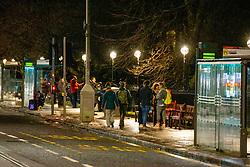 01JAN21 People on Princes Street, Edinburgh waiting to see fireworks on Hogmanay.