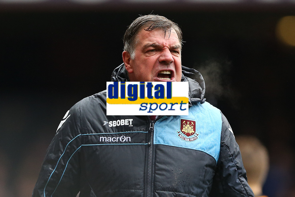 Football - The Championship - West Ham United vs Hull City FC <br /> A Furious West Ham manager Sam Allardyce unhappy with the referee for not stopping play after Gary O'Neil was hurt at Upton Park