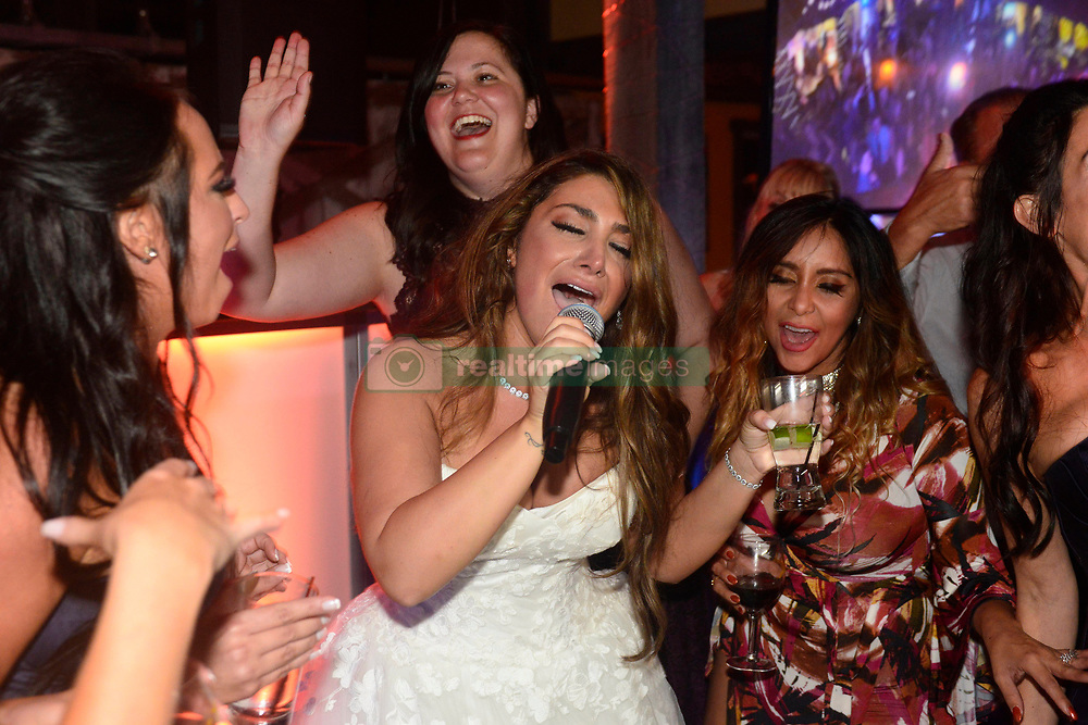 """EXCLUSIVE: 'Jersey Shore' alum, Deena Cortese reunited with her Jersey Shore castmates on Saturday as they showed up to celebrate with her and Chris Buckner. The Shore-studded wedding in Cortese's hometown of New Egypt, N.J. included guests Nicole """"Snooki"""" Polizzi, Jenni """"JWoww"""" Farley, Vinny Guadagnino, Paul """"DJ Pauly D"""" DelVecchio, Sammi """"Sweetheart"""" Giancola and Mike """"The Situation"""" Sorrentino. 28 Oct 2017 Pictured: Deena Cortese, Nicole """"Snooki"""" Polizzi. Photo credit: Aaron Showalter / MEGA TheMegaAgency.com +1 888 505 6342"""