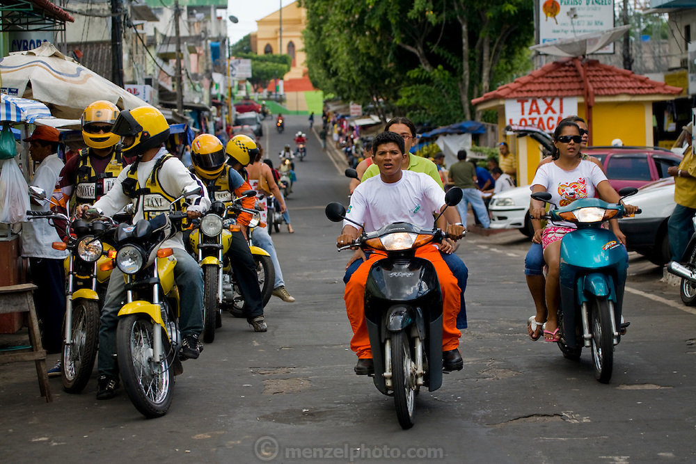 Motorcycle taxis tout for customers in Mancapuru, Brazil