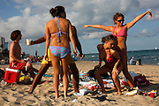 """The city earned the nickname """"Ft. Liquordale"""" in the 80s when hundreds of thousands of college students flocked to its shores every March for spring break. Chaos reigned for the whole month with a displaced frat party on steroids. Public urination/nudity/intoxication was the norm, and the quiet residents and retirees has to step aside...These days the city has clamped down on the debauchery, catering toward wealthy tourists by replacing cheap hotels with a skyline of luxury condos. Las Olas Boulevard nearby offers upscale boutiques, art galleries and fine dining. On the beach, Mounted police maintain the strict new regulations, checking IDs for underage drinking and posing a constant reminder of the consequences for bad behavior. ..But many students still return in hopes of reigniting the legend of Ft. Lauderdale beach."""