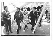 New York cop and Mickey mouse. . 1993 approx. © Copyright Photograph by Dafydd Jones 66 Stockwell Park Rd. London SW9 0DA Tel 020 7733 0108 www.dafjones.com