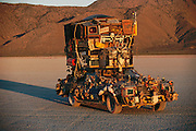 Two-story art car at sunrise at Burning Man. Burning Man is a performance art festival known for art, drugs and sex. It takes place annually in the Black Rock Desert near Gerlach, Nevada, USA.