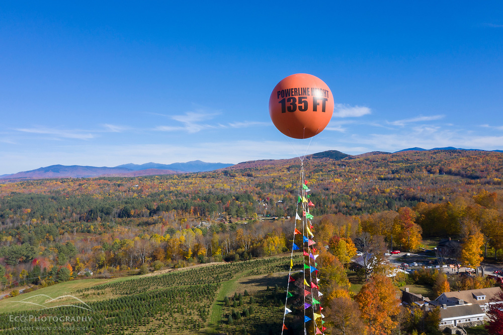 One of the balloons used to protest Northern Pass f;lies over the Rocks Estate in Bethlehem, New Hampshire, during the October 2019 Northern Pass celebration.