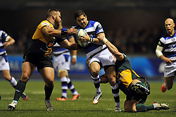 Horacio Agulla (Bath) is double-tackled in possession - Photo mandatory by-line: Patrick Khachfe/JMP - Tel: Mobile: 07966 386802 23/05/2014 - SPORT - RUGBY UNION - Cardiff Arms Park, Cardiff - Bath Rugby v Northampton Saints - Amlin Challenge Cup Final.