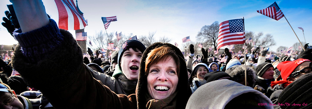 WASHINGTON, D.C. - JANUARY 20, 2009 - Hundreds of thousands, possibly the largest crowd ever assembled in the Nation's Capital, gather on the National Mall to celebrate the inauguration of Barack H. Obama as 44th, President of the United States. Inauguration-goers started to arrive and assemble the night before to find a position to watch on the Mall. <br /> Photography ©DONNA FISHER / The Morning Call