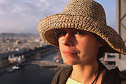 Faith D'Aluisio with hat above Barcelona, Spain.  MODEL RELEASED.