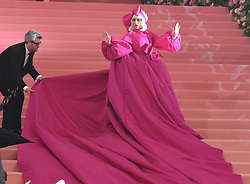 Lady Gaga Arrives on the Pink carpet for the Met Gala 2019, Lady Gaga steals the show with a master performance on the Pink carpet, stripping off her dresses down to her underwear. 06 May 2019 Pictured: Lady Gaga. Photo credit: Neil Warner/MEGA TheMegaAgency.com +1 888 505 6342