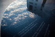 MONTGOMERY, AL -- 5/24/17 -- The sky is reflected in the Civil Rights Memorial commissioned by the Southern Poverty Law Center and dedicated in 1989. The memorial is the cornerstone of the Civil Rights Memorial Center which is housed in the former offices of the SPLC. <br /> Civil Rights attorney Morris Dees co-founded the Southern Poverty Law Center in 1971. The group has taken on the Ku Klux Klan and fought for against hate for decades, but is now facing criticism that it has labeled some groups without just cause..…by André Chung #_AC17226