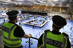Police on duty as election staff count ballot papers for the General Election, at the Emirates Arena in Glasgow.