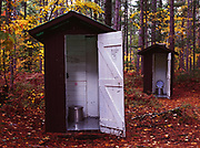 Pair of outhouses in north woods, Culhane Lake State Forest Campground, Upper Peninsula of Michigan.