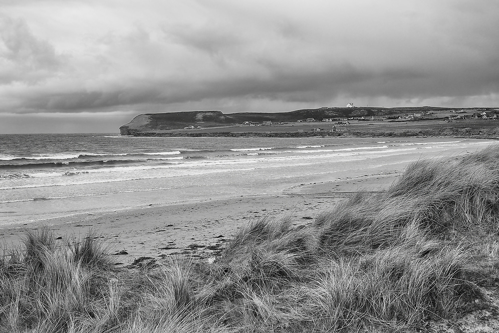 Taken from one of the sand dunes along Dunnet Beach, you can see Dunnet Hill on the left & buildings. These make up the small village that stands at the base of Dunnet Head, the most northenley point on the British mainland.<br /> <br /> <br /> Photo by Jonathan J Fussell, COPYRIGHT 2017