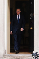Downing Street, London, March 30th 2015. British Prime Minister David Cameron emerges from 10 Downing street on his way to visit the Queen to announce the May 7th general election.