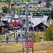 Andrew Whiteford, Kyle Dowman, and Rob LaPier ride the lift accessed trails and features of Jackson Hole Mountain Resort in Teton Village, Wyoming.
