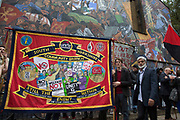 Anti fascists gather in front of the Battle of Cable Street mural in St Georges Gardens during the Cable Street 80 march and rally through Whitechapel to mark the 80th anniversary of the Battle of Cable Street on 9th October 2016 in London, United Kingdom. The demonstration marks the day when tens of thousands of people across the East End, joined by others who came to support them, prevented Oswald Mosley's British Union of Fascists invading the Jewish areas of the East End. The day, which is recognised as a major turning point in the struggle against fascism in Britain in the 1930s.