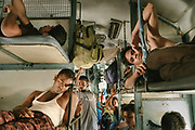 Tightly packed bodies twist and bend to fill every crevice of the train car.<br /> Inside the Dibrugarh-Kanyakumari Vivek Express, the longest train route in the Indian Subcontinent. It joins Kanyakumari, Tamil Nadu, which is the southernmost tip of mainland India to Dibrugarh in Assam province, near the border with Burma.