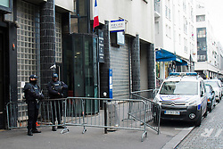 © Licensed to London News Pictures. 08/01/2016. Paris, France.. Armed police stand guard outside Goutte D'Or police station in Northern Paris where police shot a man dead who threatened officers with a knife yesterday afternoon, January 7th. Photo credit: Hugo Michiels/LNP