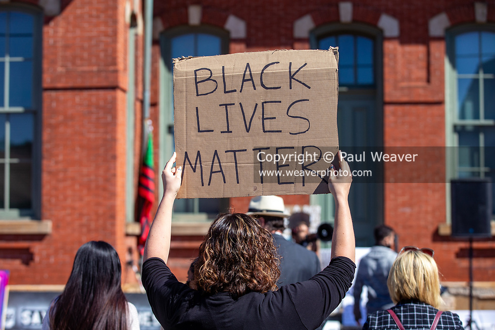 A protester holds a sign at a Black Lives Matter rally organized by the anti-racist collective 'If Not Us, Then Who?' in Milton, Pennsylvania.