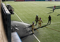 Emergency services extinguish a fire that broke out after an England training session at Estadi Nacional, Andorra. The fire puts England's World Cup 2022 qualifier against Andorra in doubt. Picture date: Friday October 8, 2021.