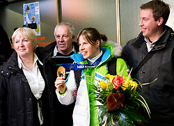 Vesna Fabjan, bronze medalist in cross country with her family at reception of Slovenia team arrived from Winter Olympic Games Sochi 2014 on February 19, 2014 at Airport Joze Pucnik, Brnik, Slovenia. Photo by Vid Ponikvar / Sportida