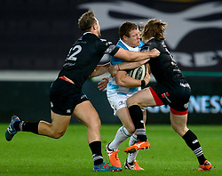 Leinster's Sean Cronin is tackled by Ospreys' Jeff Hassler and Ashley Beck<br /> <br /> Photographer Simon King/Replay Images<br /> <br /> Guinness PRO14 Round 19 - Ospreys v Leinster - Saturday 24th March 2018 - Liberty Stadium - Swansea<br /> <br /> World Copyright © Replay Images . All rights reserved. info@replayimages.co.uk - http://replayimages.co.uk