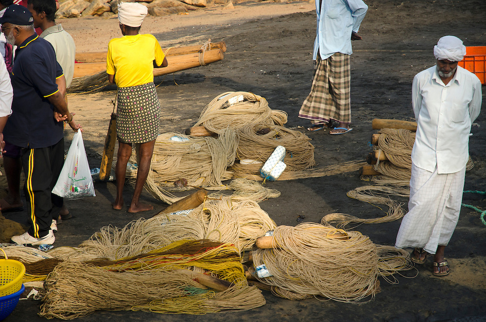 Fishermen work early in the morning on Varkala beach, Kerala, Indian Subcontinent