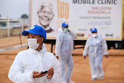 ALEXANDRA SOUTH AFRICA - APRIL 25: Health workers during intensified testing and screening on Freedom Day, screening and testing includes people over over 60, flu-like symptoms, comorbid conditions, like diabetes, asthma, hypertencsion, HIV and tuberculosis on April 25, 2020 in Alexandra South Africa. Under pressure from a global pandemic. President Ramaphosa declared a 21 day national lockdown extended by another two weeks, mobilising goverment structures accross the nation to combat the rapidly spreading COVID-19 virus - the lockdown requires businesses to close and the public to stay at home during this period, unless part of approved essential services. (Photo by Dino Lloyd)