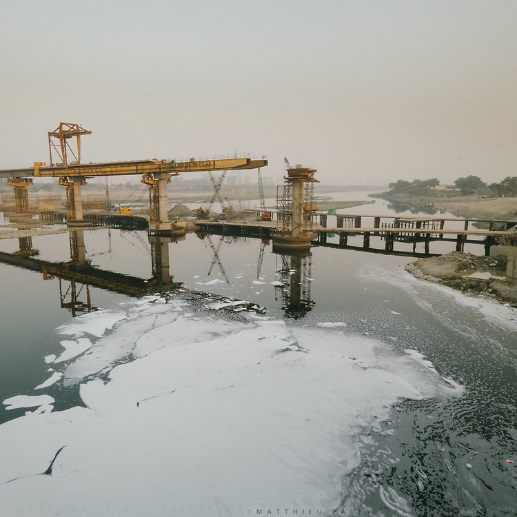 Construction projects over the polluted Yamuna river in Delhi.<br /> Industrial waste with all toxic chemicals has caused formation of foam over the river.