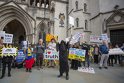© Licensed to London News Pictures.  11/08/2021. London, UK. Supporters of Wikileaks founder Julian Assange protest outside the Royal Courts of Justice in central London. The High Court will hear the first stage of a bid by the US government to appeal against a judge's decision not to extradite Julian Assange to face trial on espionage charges in America.  Photo credit: Marcin Nowak/LNP