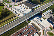 Nederland, Flevoland, Gemeente Dronten, 01-05-2013; NS Station, onderdeel van de Hanzelijn. PR Park and Ride en OV, busstation.<br /> New constructed railway station and bus station  in Dronten, parking system Park and Ride, car drivers park and take the train to their destination.<br /> luchtfoto (toeslag op standard tarieven);<br /> aerial photo (additional fee required);<br /> copyright foto/photo Siebe Swart