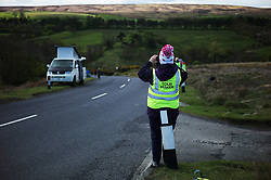 (c) Licensed to London News Pictures. <br /> 28/04/2017<br /> Goathland, UK<br /> <br /> A marshall waits for the approach of riders taking part in the Tour de Yorkshire cycling race pass through Goathland on Stage 1 of the three stage race.<br /> <br /> Photo Credit: Ian Forsyth/LNP