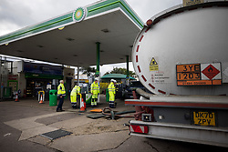 © Licensed to London News Pictures. 05/10/2021. Waltham Abbey, UK. Military personnel seen refuelling a petrol station in Waltham Abbey, Hertfordshire. Military personnel have started helping with driver shortages following more than a week of long queues and closures at petrol stations. Photo credit: Ben Cawthra/LNP