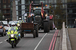 Licensed to London News Pictures. 12/10/2020. London, UK. Farmers are seen driving tractors through Lambeth Bridge, central London to urge the government to protect food standards bill in post-Brexit trade bill. Photo credit: Marcin Nowak/LNP