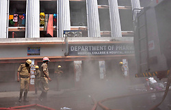 October 3, 2018 - Kolkata, West Bengal, India - Firefighters douse the fire which broke out at the pharmacy department of Calcutta Medical College and Hospital. A fire broke out at the Calcutta Medical College and Hospital pharmacy department , more than 250 patients were evacuated and no casualty has been reported. (Credit Image: © Saikat Paul/Pacific Press via ZUMA Wire)