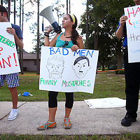 GAINESVILLE, FL -- Sept. 10, 2010 -- Diana Moreno, a University of Florida student, protests Florida pastor Terry Jones, whose plans are on hold to burn the Koran on Sept. 11th, outside of the Dove World Outreach Center in Gainesville, Fla., on Friday, September 10, 2010.  (Chip Litherland for The New York Times)