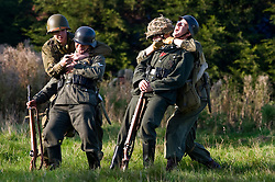 US Airborne troops sneak up on two German sentries during a small scale Skirmish at the Northallerton Wartime weekend charity fundraiser for Help for Heros and Ben Hyde Memorial Trust 9th &10th Ocober 2010 .Images <br /> © Paul David Drabble