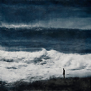 Rough seascape and silhouette of a man digitally distorted and treated