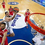 Anadolu Efes's Jordan Farmar (2ndL) during their Turkish Airlines Euroleague Basketball playoffs Game 3 Anadolu Efes between Olympiacos at Abdi ipekci Arena in Istanbul, Turkey, Wednesday, April 17, 2013. Photo by Aykut AKICI/TURKPIX