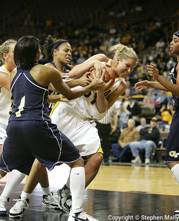 28 NOVEMBER 2007: Iowa forward Krista VandeVenter (51) tries to hold onto the ball in the first half of Georgia Tech's 76-57 win over Iowa in the Big Ten/ACC Challenge at Carver-Hawkeye Arena in Iowa City, Iowa on November 28, 2007.