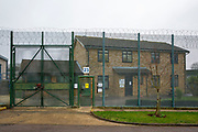The entrance gate to the resettlement centre behind a fence inside HMP Downview, Surrey, United Kingdom. The centre provides help for prisoners who are close to their release date with things like housing and work. HMP Downview is a women's closed category prison for adult sentenced women and convicted and remand female young people located on the outskirts of Banstead in Surrey, England. (Picture credit: © Andy Aitchison)