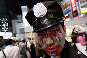 A Japanese man dressed as a police officer during the Halloween celebrations Shibuya, Tokyo, Japan. Saturday October 27th 2018. The celebrations marking this event have grown in popularity in Japan recently. Enjoyed mostly by young adults who like to dress up, drink , dance and misbehave in parts of Tokyo like Shibuya and Roppongi. There has been a push back from Japanese society and the police to try to limit the bad behaviour.