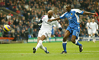 Photo: Aidan Ellis.<br /> Bolton Wanderers v Wigan Athletic. The Barclays Premiership. 04/11/2006.<br /> Bolton's Nicolas Anelka (L) comes close with this effort whilst Wigan's Emerson Boyce cant catch him