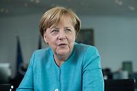 23 AUG 2017, BERLIN/GERMANY:<br /> Angela Merkel, CDU, Bundeskanzlerin, waehrend einem Interview, in Ihrem Buero, Bundeskanzleramt<br /> IMAGE: 20170823-02-010<br /> KEYWORDS: Büro