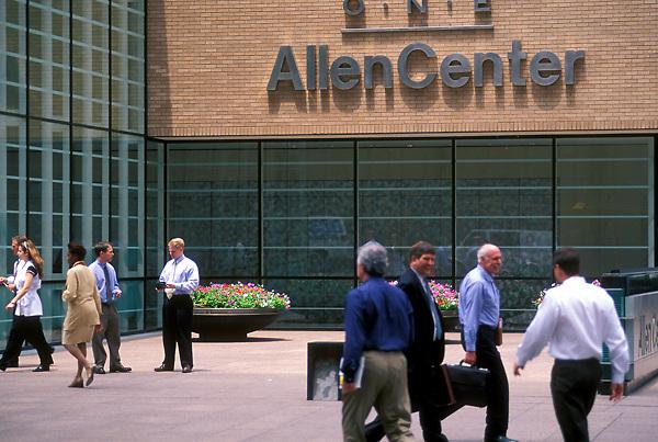 Stock photo of pedestrians walking around One Allen Center in the afternoon